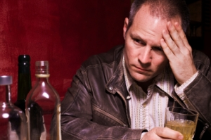 Sad man drinking in bar